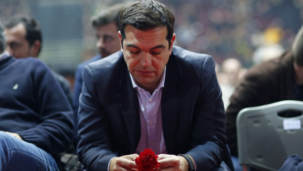 Alexis Tsipras, leader of the Syriza party, holds a clove flower as he attends a pre-election party congress in Athens, Greece, on Saturday, Jan. 3, 2015. Greece's political parties embarked on a flash campaign for elections in less than three weeks that Prime Minister Antonis Samaras said will determine the fate of the country's membership in the euro currency area. Photographer: Kostas Tsironis/Bloomberg via Getty Images